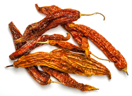 Aji amarillo, dry pepper from the Peruvian cuisine. Isolated on white.
