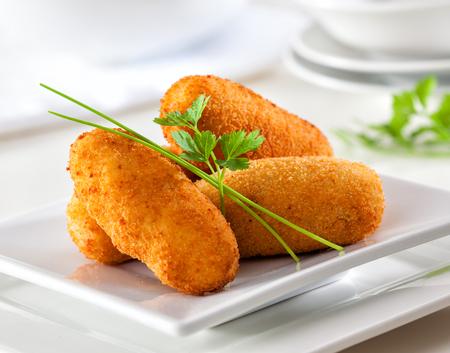 Foto für Delicious homemade gourmet croquettes on white plate. - Lizenzfreies Bild