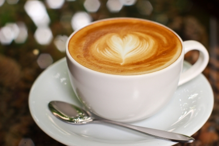 Cappuccino or latte coffee with heart shape