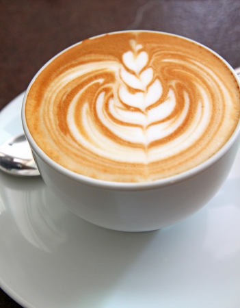 Cup of art latte on a cappuccino coffee