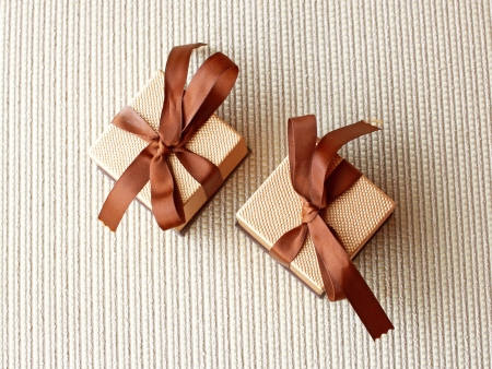 Two luxury gift boxes with ribbon and bow
