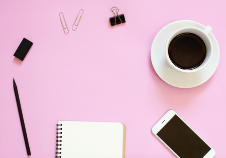 Creative header design mockup set of workspace desk with smartphone, coffee, stationery and notebook with copy space background