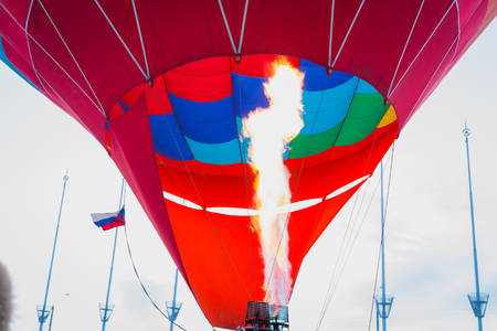 Balloon crew inflates envelope of hot air balloon at festival