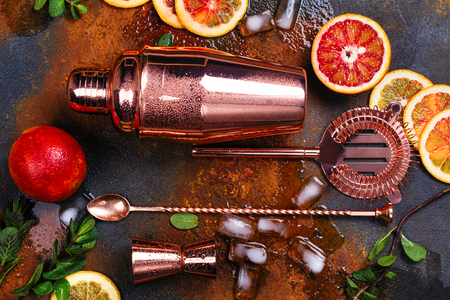 Photo pour Bar accessories, drink tools and cocktail ingredients on rusty stone table. Flat lay style - image libre de droit