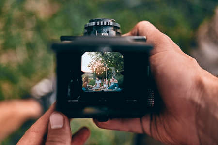Photo for Photographer is making a photography with old camera. Top view. - Royalty Free Image