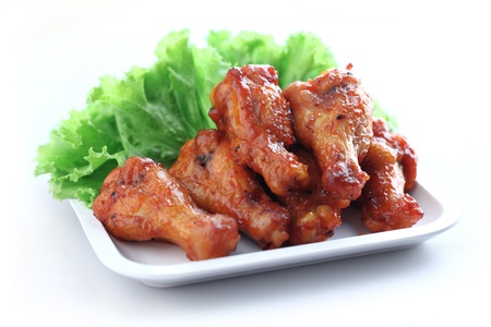 Plate of chicken wings on white background