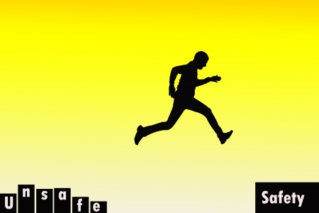 Silhouette of a man jumping from unsafe location to safe location