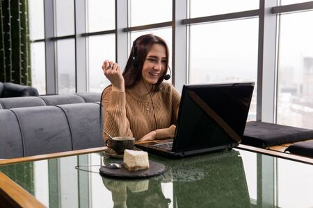 Photo for girl leads an amateur online broadcast from the coffee shop - Royalty Free Image