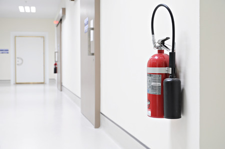 Install a fire extinguisher on the wall in hospital