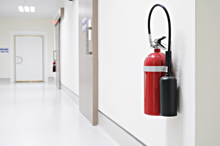 Photo for Install a fire extinguisher on the wall in buiding - Royalty Free Image
