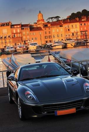the nice sporting car in front of the houses of saint tropez