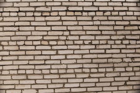 Old brick wall with light bricks