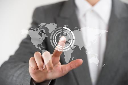 Photo pour Business woman pointing her finger on virtual button on world map - image libre de droit