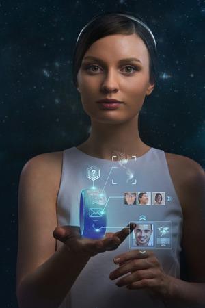 Photo pour Woman holding wearable gadget. New technologies. Wireless tools. Future communications and social media concept. - image libre de droit