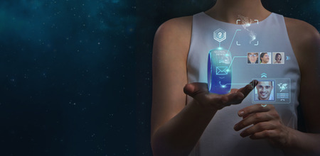 Unrecognizable woman holding wearable gadget. New technologies. Wireless tools. Future communications and social media concept.