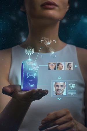 Photo pour Unrecognizable woman holding wearable gadget. New technologies. Wireless tools. Future communications and social media concept. - image libre de droit