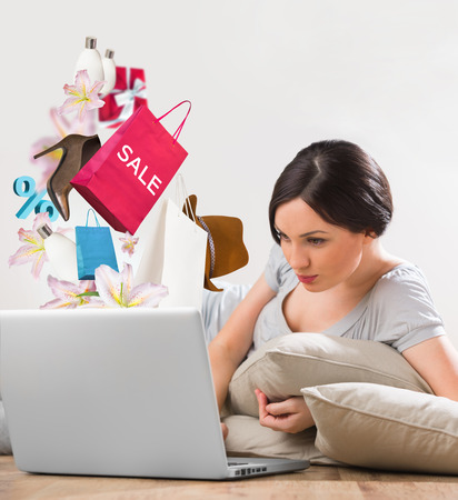 Woman shopping online using her laptop at home