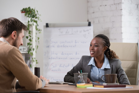Emotional businesswoman gesturing during meeting at office