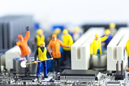 Photo pour Team of engineers repairing circuit mother board. Computer repair concept - image libre de droit