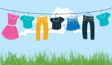clothes on washing line against blue sky and green grass