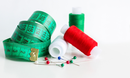 Foto de Bright Sewing Kit. Thread and Needle. Tailor Concept - Imagen libre de derechos