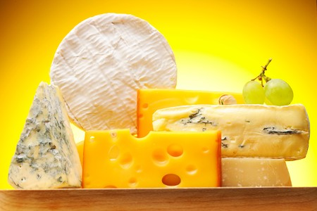 Various types of cheese on boardの写真素材