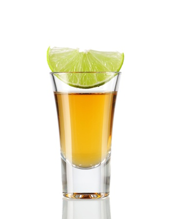 Tequila  shot with lime isolated on white