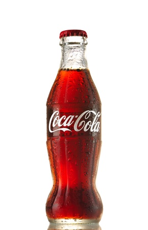 Moscow, Russia - May 22, 2011: Classic  bottle Of Coca-Cola isolated on white studio shot.  Classic bottle of coca-cola in ice.