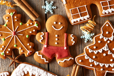Photo for Christmas homemade gingerbread cookies on wooden table - Royalty Free Image