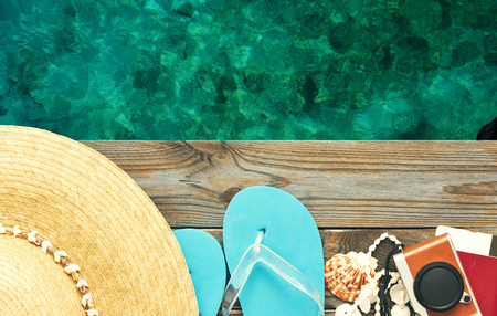 Foto de Travel and beach items at jetty - Imagen libre de derechos
