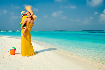 Photo pour Three year old toddler boy on beach with mother. Summer family vacation at Maldives. - image libre de droit