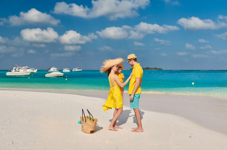 Photo pour Family on beach, young couple in yellow with three year old boy. Summer vacation at Maldives. - image libre de droit