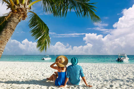 Photo for Couple in blue clothes on a tropical beach at Maldives - Royalty Free Image