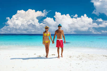 Foto für Couple walking on a tropical beach. Perhentian islands, Malaysia. - Lizenzfreies Bild