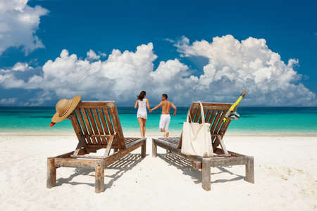 Photo for Couple in white running relax on a tropical beach at Maldives - Royalty Free Image