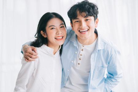 Photo pour Asian couple happily embracing each other - image libre de droit