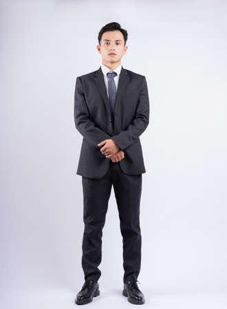 Photo pour Young Asian businessman standing on white background - image libre de droit