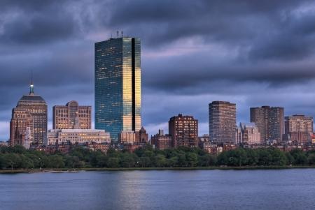 Golden light illuminated the Boston Skyline viewed over the Charles River