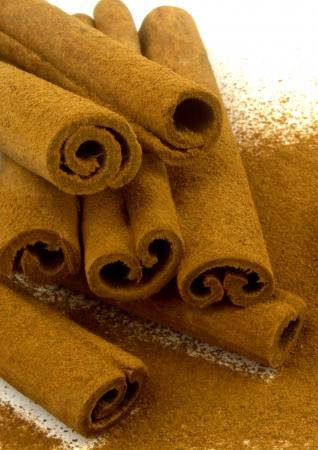 Grounded cinnamon on cinnamon sticks