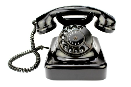 Photo pour Old rotary phone on white background. - image libre de droit