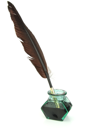 Quill pen in glass ink bottle