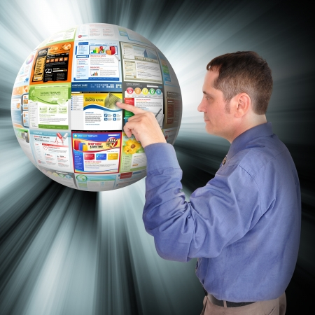 A business man is pointing to an abstract internet ball with websites on it  There are glowing rays coming out of it  Use it for a technology concept
