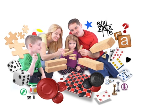 A happy fammily is playing with various games of puzzles, blocks and checkers on an isolated white background.