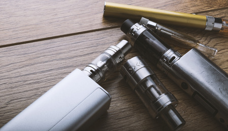 Photo pour vaping devices or electronic cigarette on a wooden background - image libre de droit