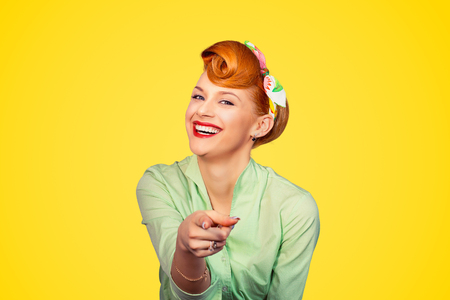 Foto de Portrait of a beautiful woman pinup retro style pointing at you smiling laughing isolated yellow background wall. Body language, gestures, psychology. Bullying someone concept - Imagen libre de derechos
