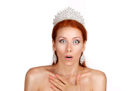 Photo pour Wow. Woman surprised hands on cheeks looking at you camera amazed shocked pretty woman with crystal crown on head isolated on white background wall - image libre de droit