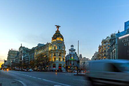 MADRID, SPAIN - JANUARY 23, 2018:  Sunset view of Gran Via and Metropolis Building (Edificio Metropolis) in City of Madrid, Spain
