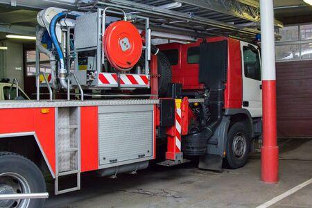 Foto für red and white fire truck in the garage - Lizenzfreies Bild