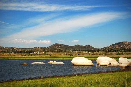 Rocks in Lake Morena with sky