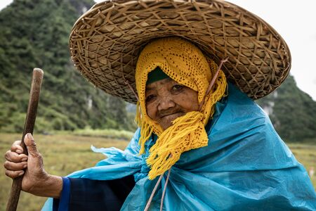 Old Woman with a big straw hat from Vietnam